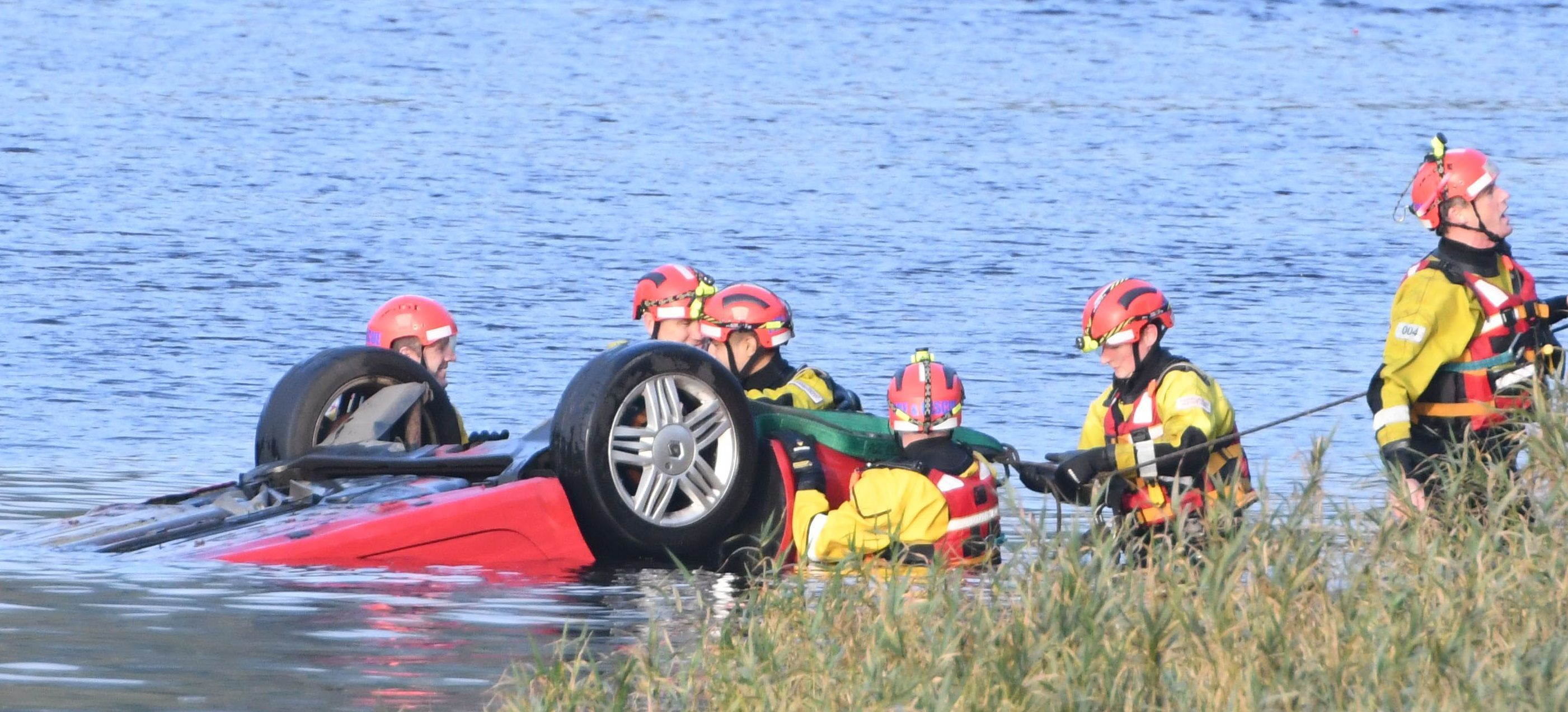 Emergency crews removing the car from the River Tay on Tuesday.