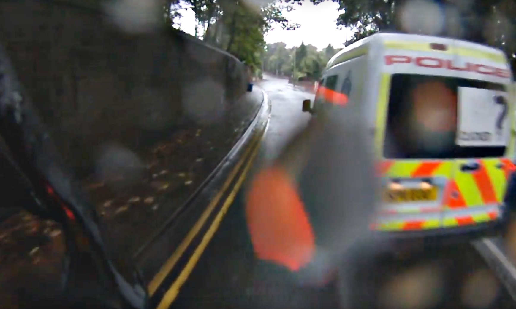 The police van passing cyclist David Evans.