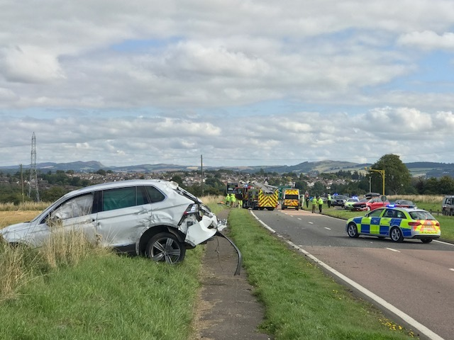 Police closed the road following the four-car crash.