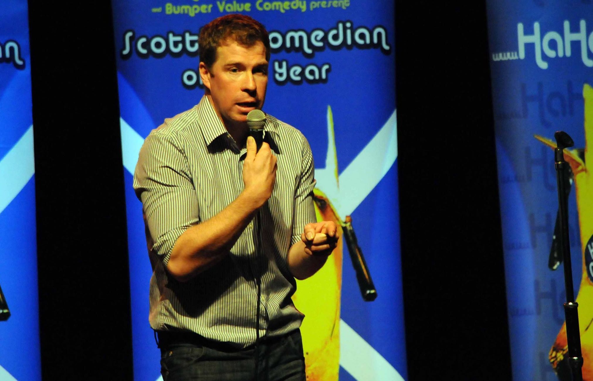 Comedian Jim Smith on stage.