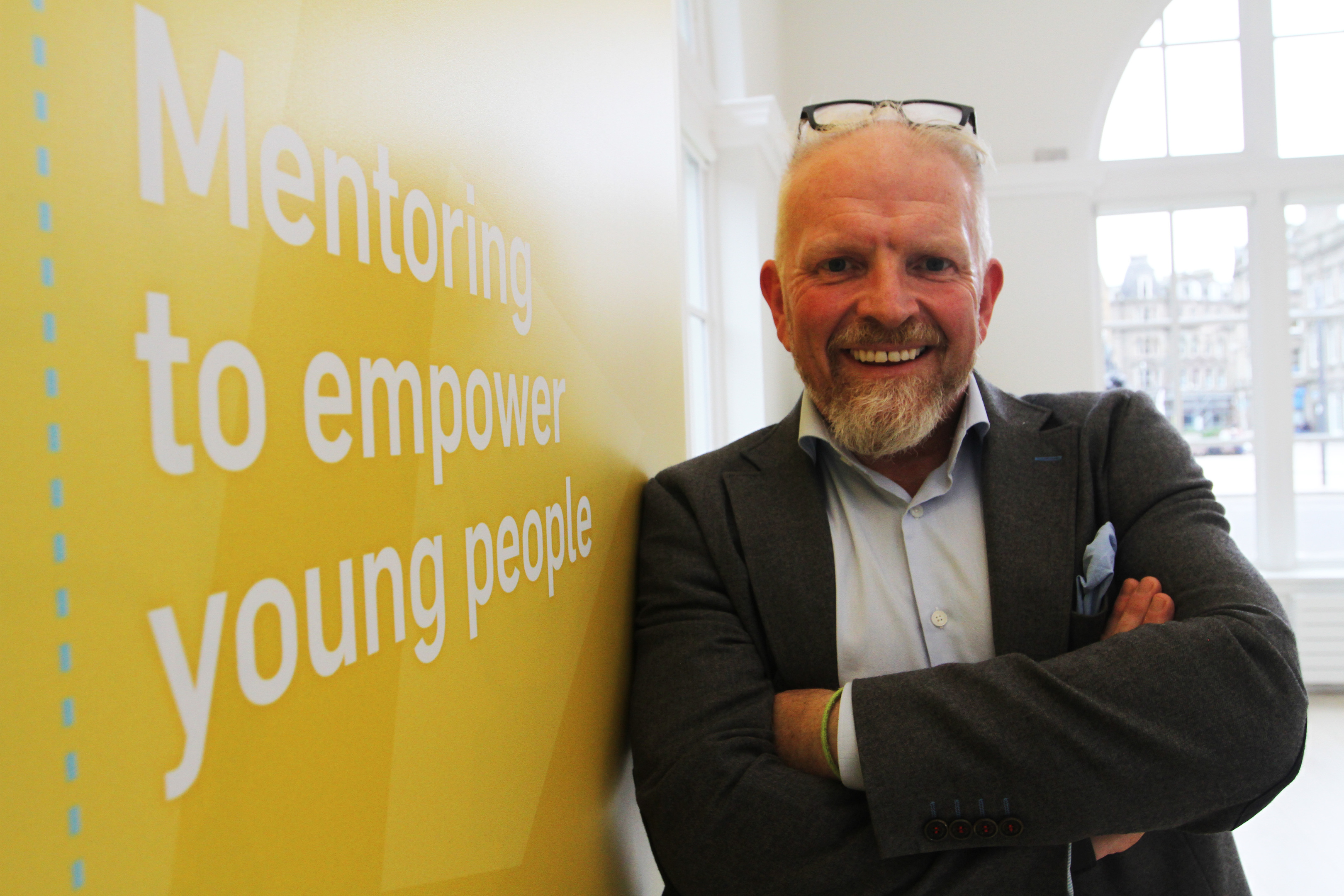 Ellis Watson of DC Thomson with the artwork designed by young people for the charity.