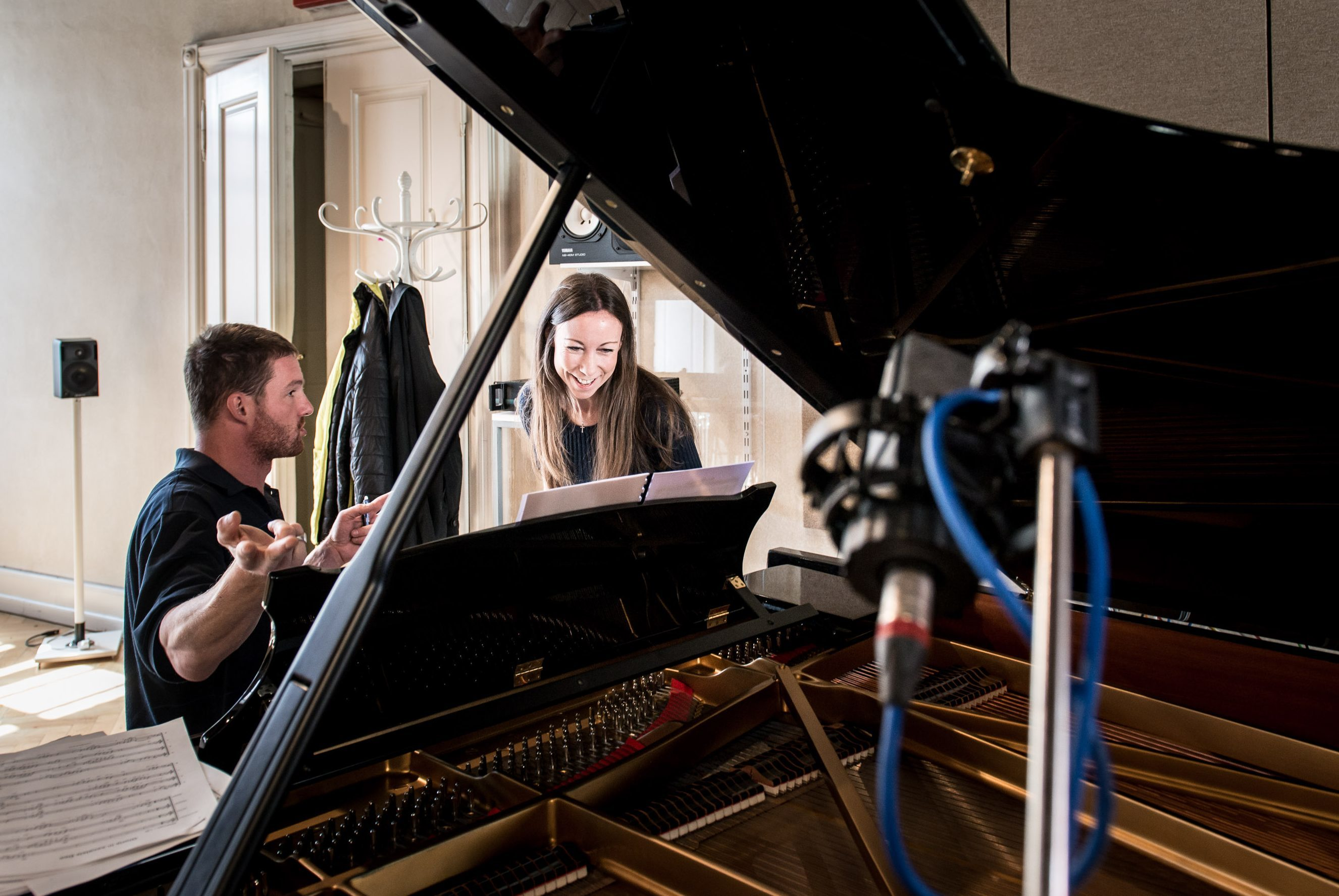 Composer Helen MacKinnon joins conductor Jiří Petrdlík,  at the recording session in Prague.