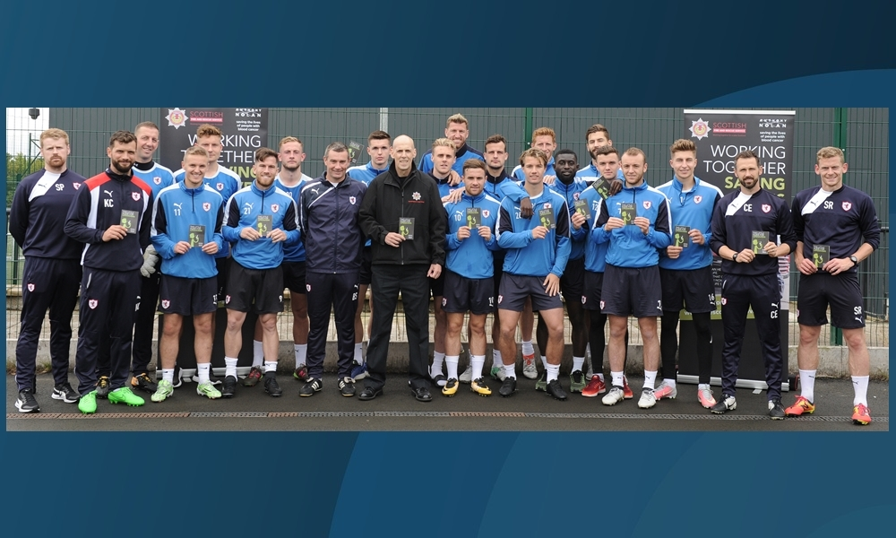 Firefighter Gary Dall (centre) with Raith Rovers players at the launch of the appeal.