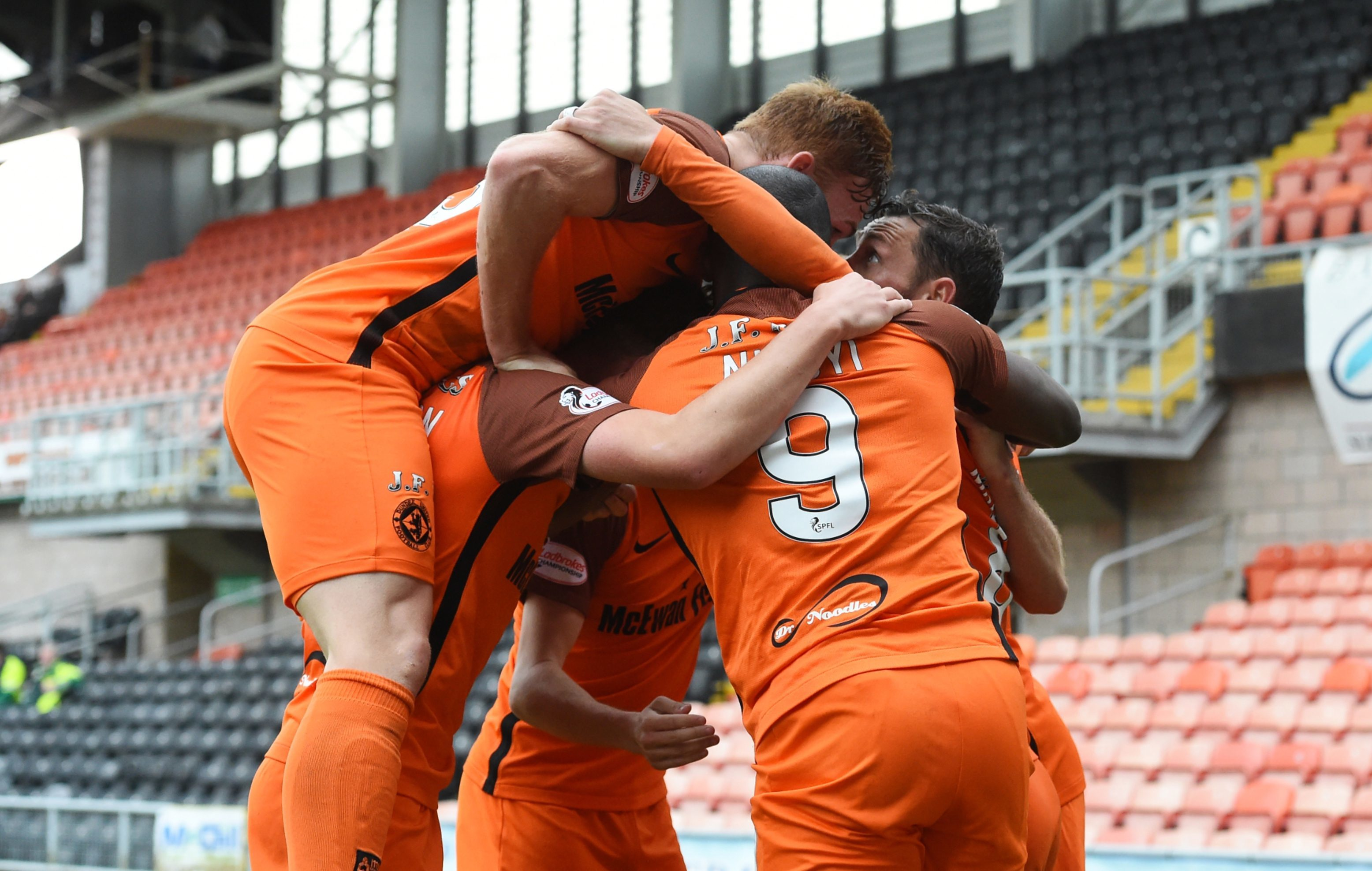 United players pile in to celebrate after Scott McDonald scores the winner against Morton.