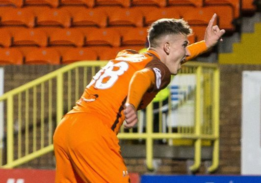 Dundee United's Logan Chalmers celebrates his late winner against Linfield.