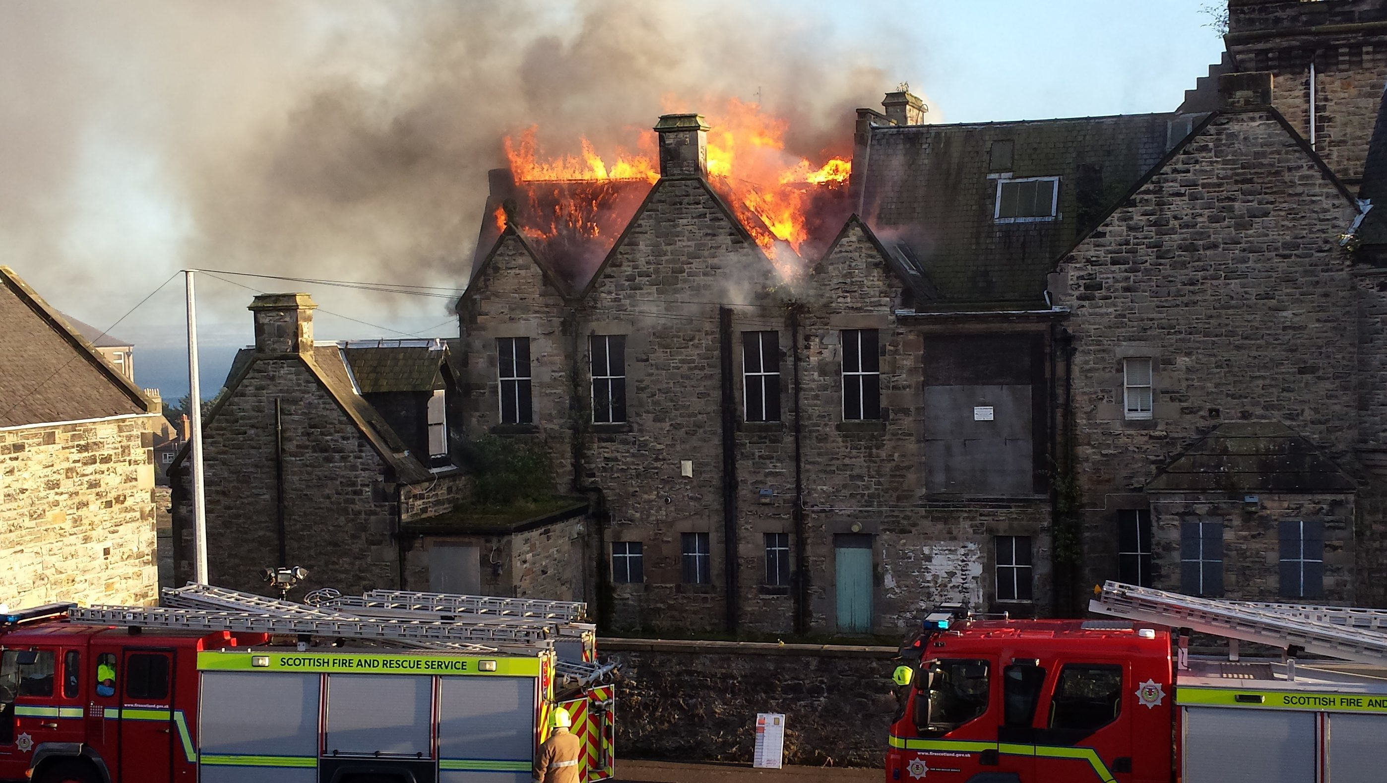 Firefighters tackling the blaze.