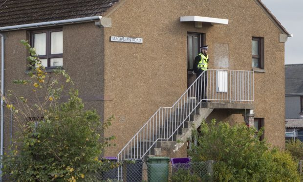 A police presence remained at a flat in Maclagan Road, Carnoustie.