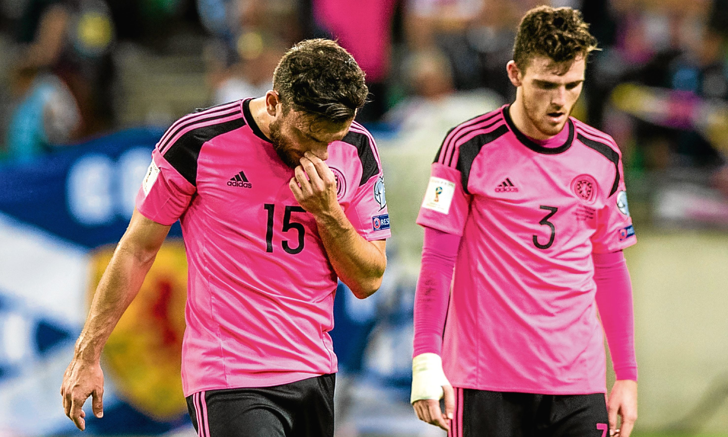Dejection for Scotland's Robert Snodgrass and Andrew Robertson at full-time.