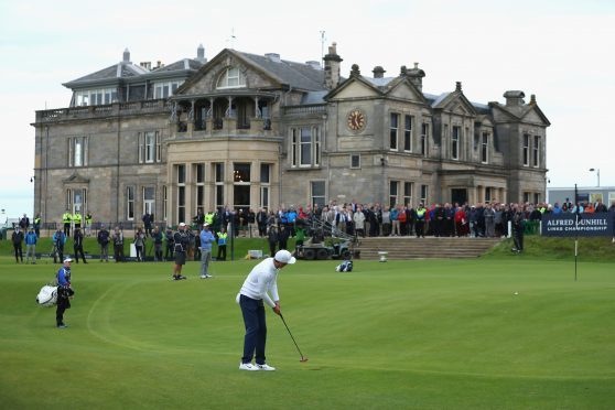 Ross Fisher putts for a 59 on the 18th at the Old Course in the final round of the Alfred Dunhill Links Championship. He took a further two to get down, but dstill set a new course record.
