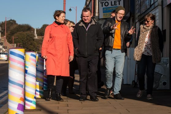 Artists show council employees their artistic bollards