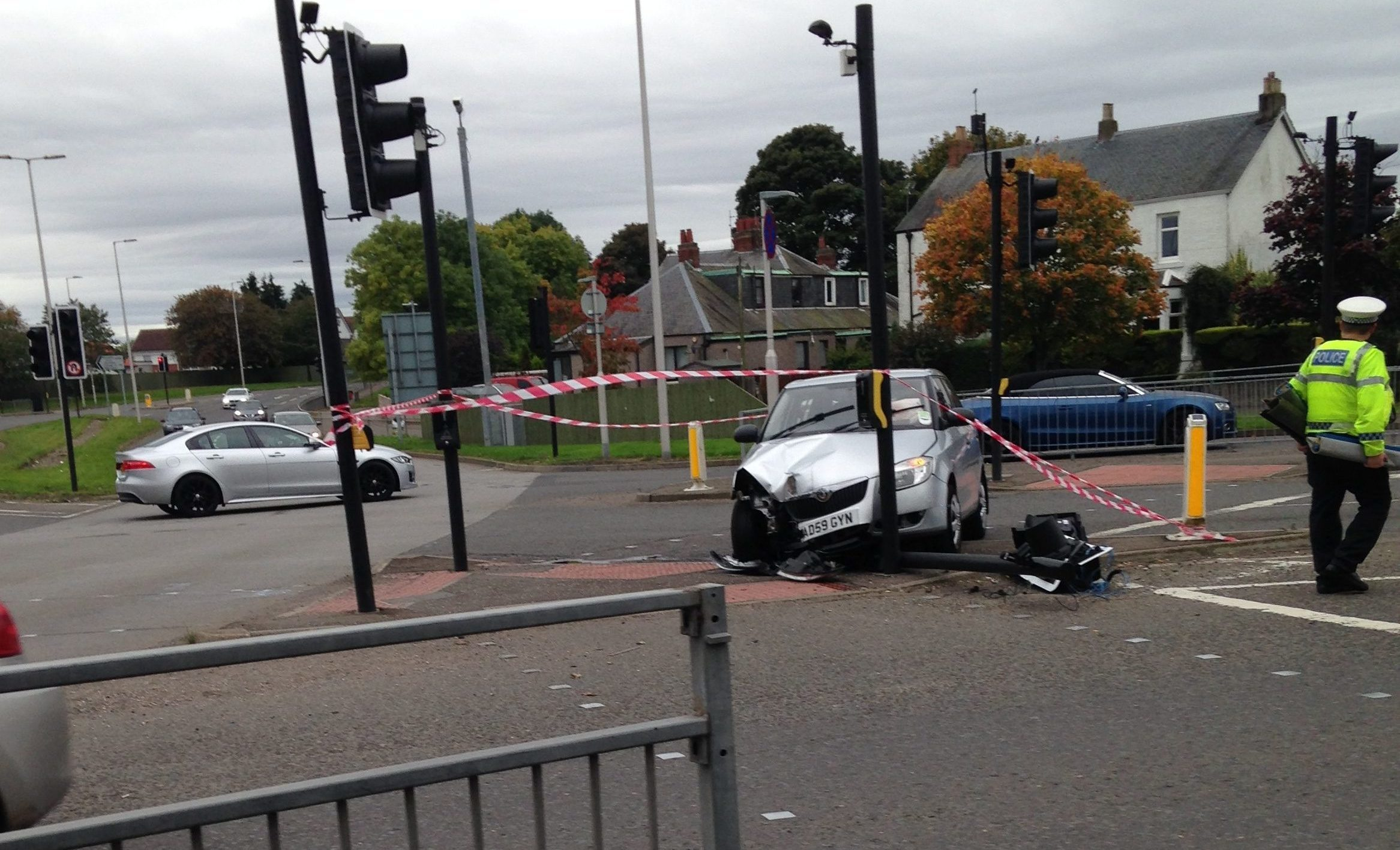The elderly driver collided with a set of traffic lights
