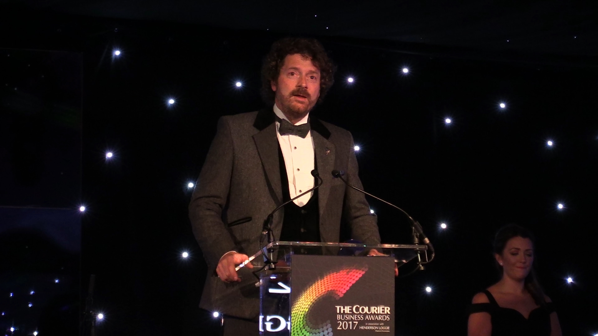 Chris van der Kuyl on stage at the Courier Business Awards.