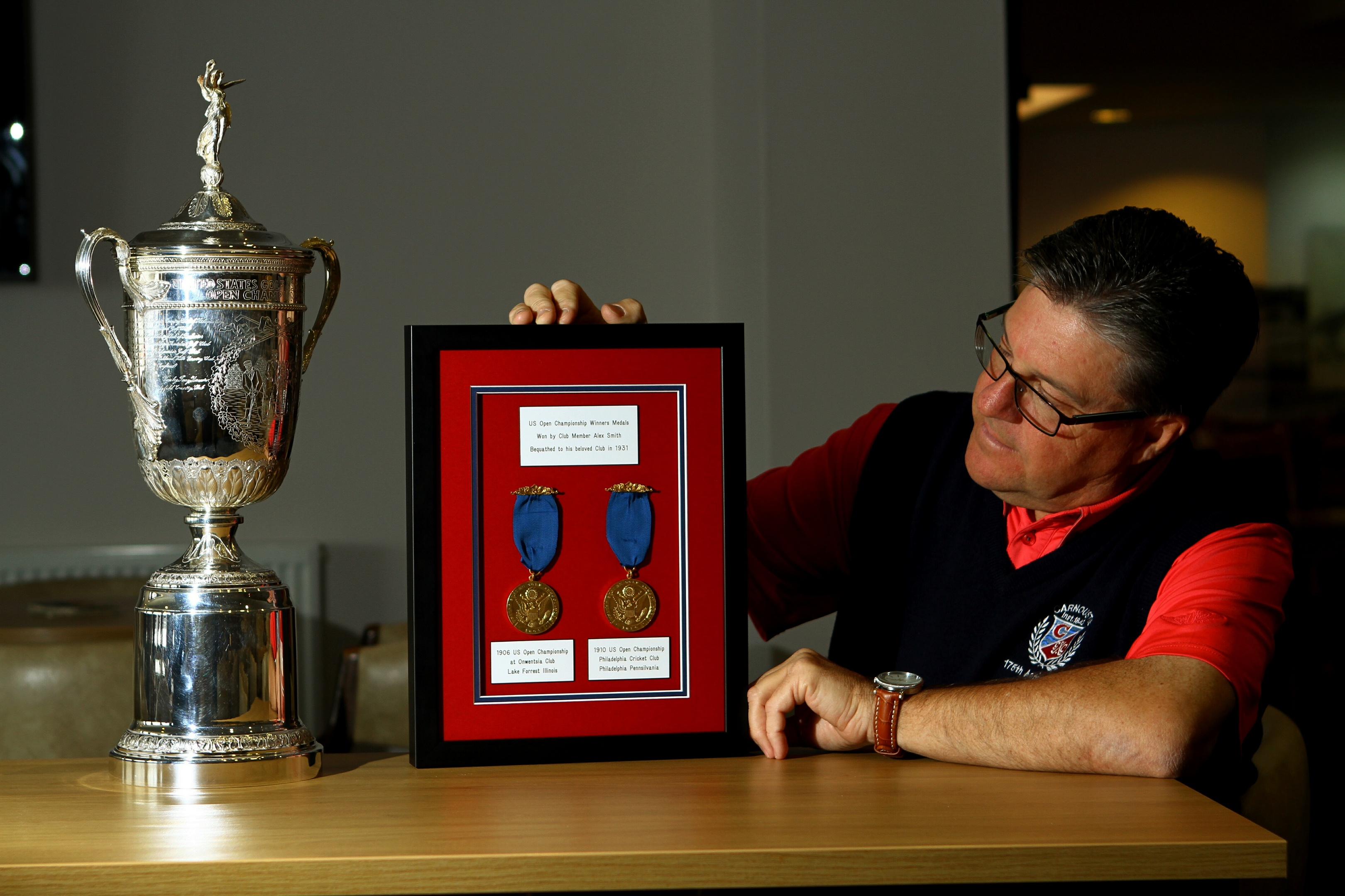 Carnoustie Golf Club Captain Bill Thompson, with the US Open Championship trophy and US Open Championship winning medals from 1906 and 1910