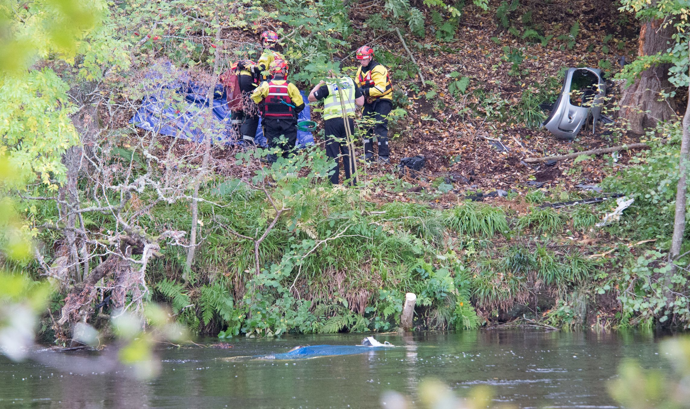 Emergency services at the River Tay after being alerted to a car in the water just west of Aberfeldy.