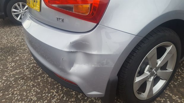 The dent in the courtesy Audi.
