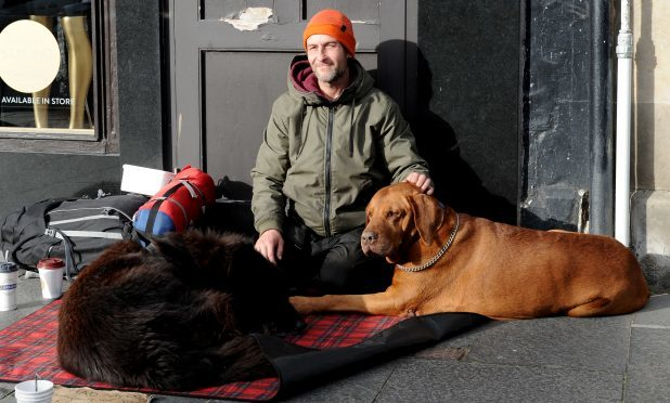 Homeless man John Hunter and his pet dogs.