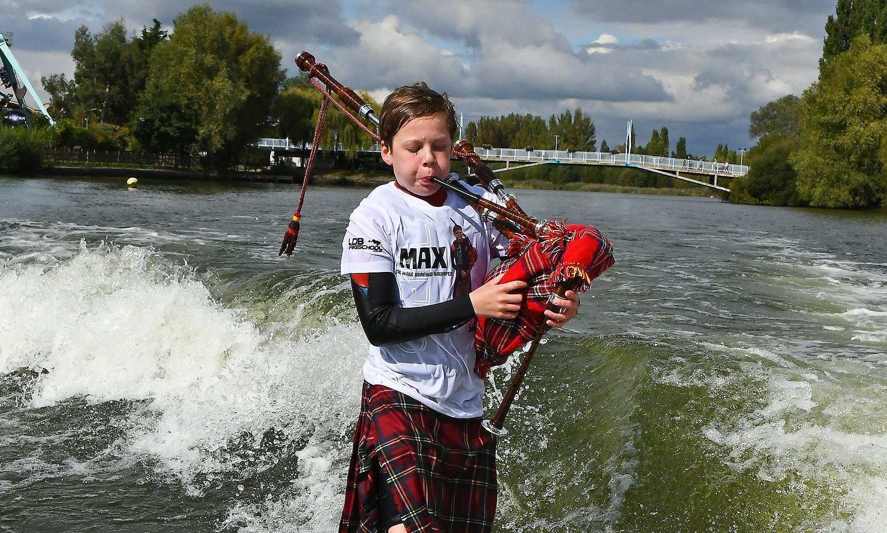Max Rae wakesurfing with his pipes.