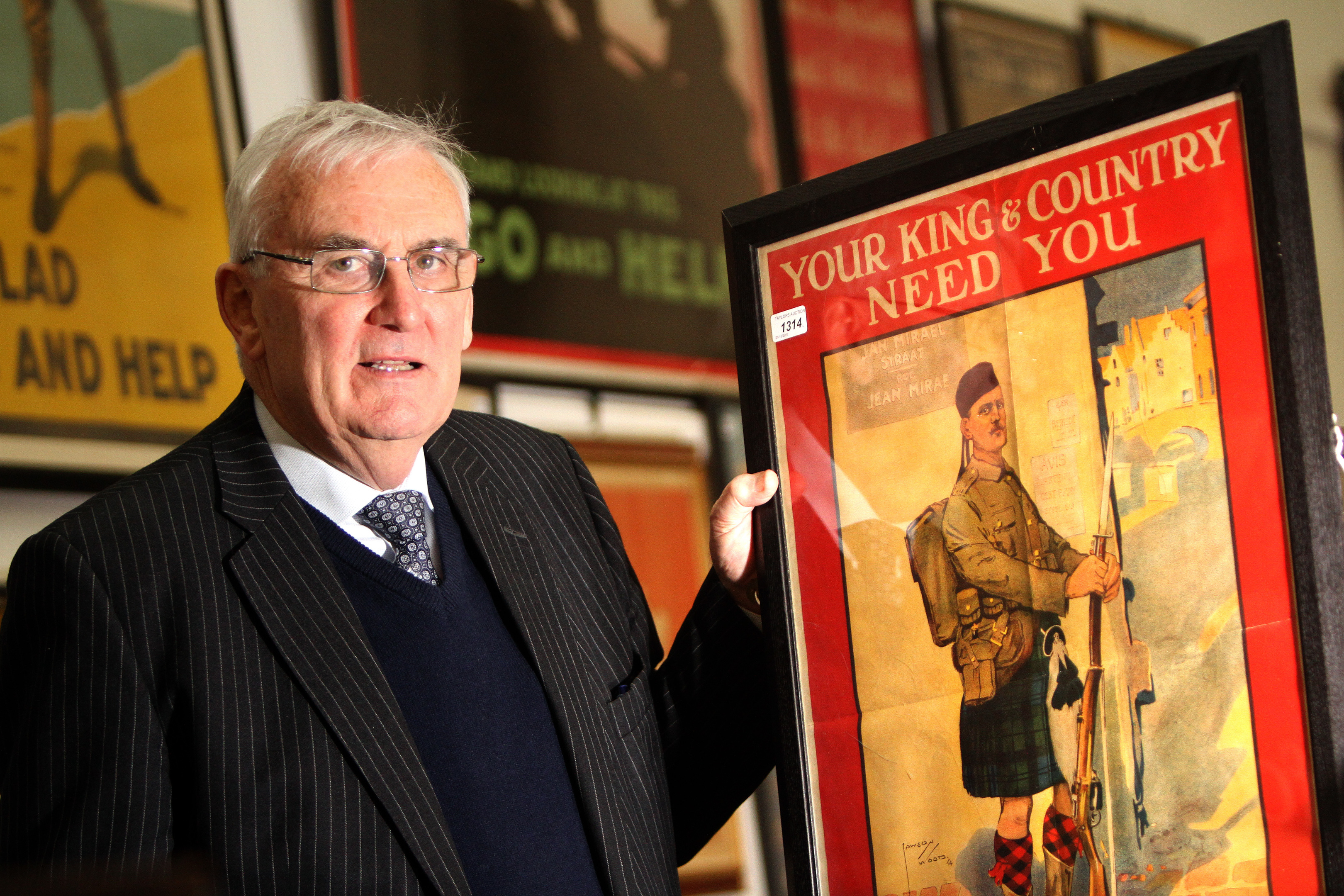 Auctioneer Ian Taylor with one of the posters
