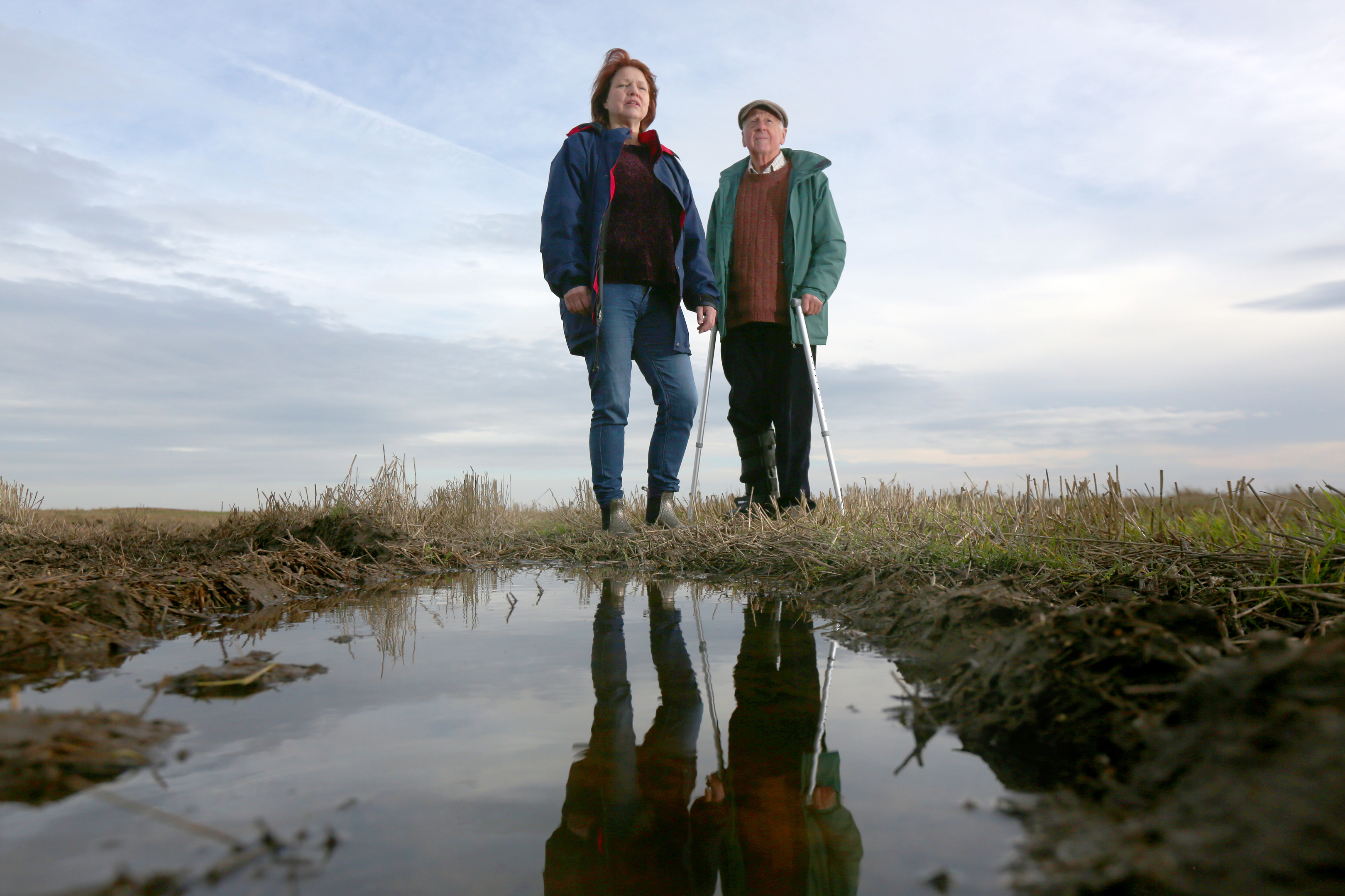 Cllr Linda Holt and campaigner Graham Lang overlooking land near the proposed site.