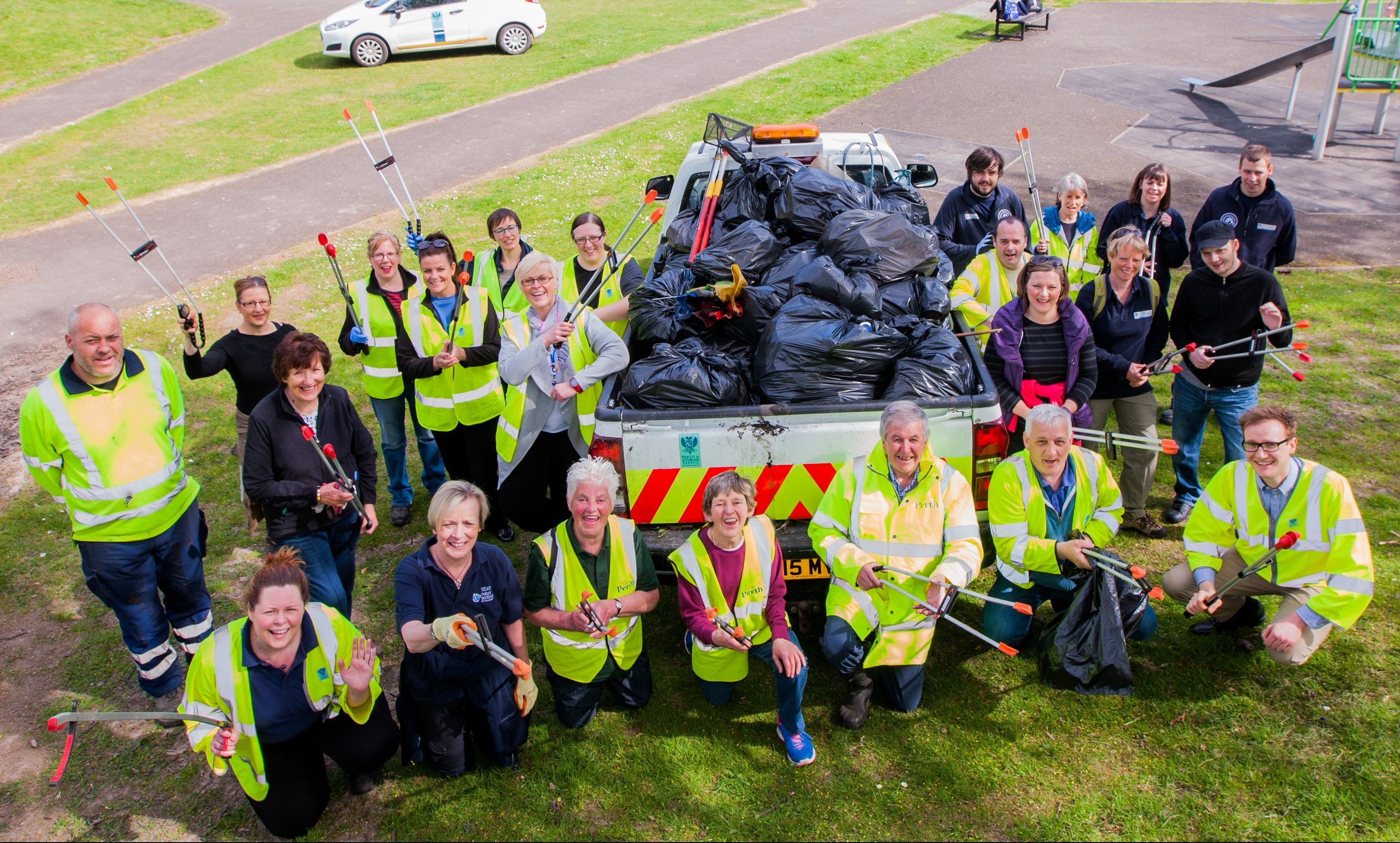 Perth and  Kinross Council, Community Greenspace and Beautiful Perth working together. Picture shows most of those that helped to clean up the Lade with the rubbish in black bags.