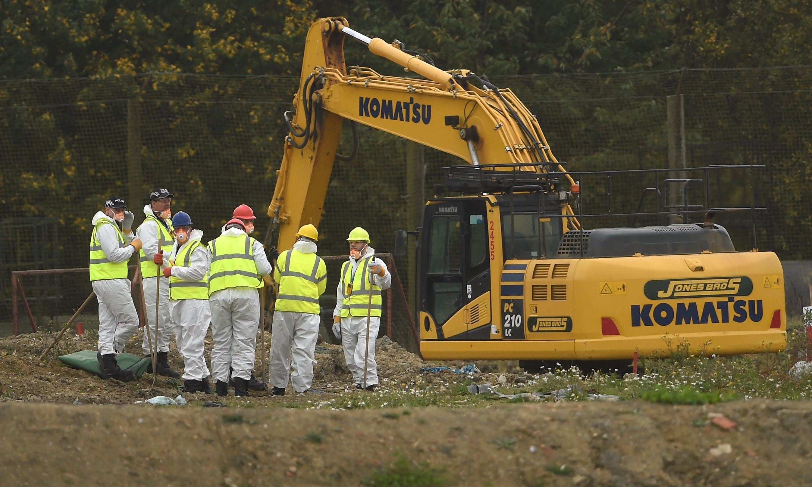 Police searching the landfill site at Milton.
