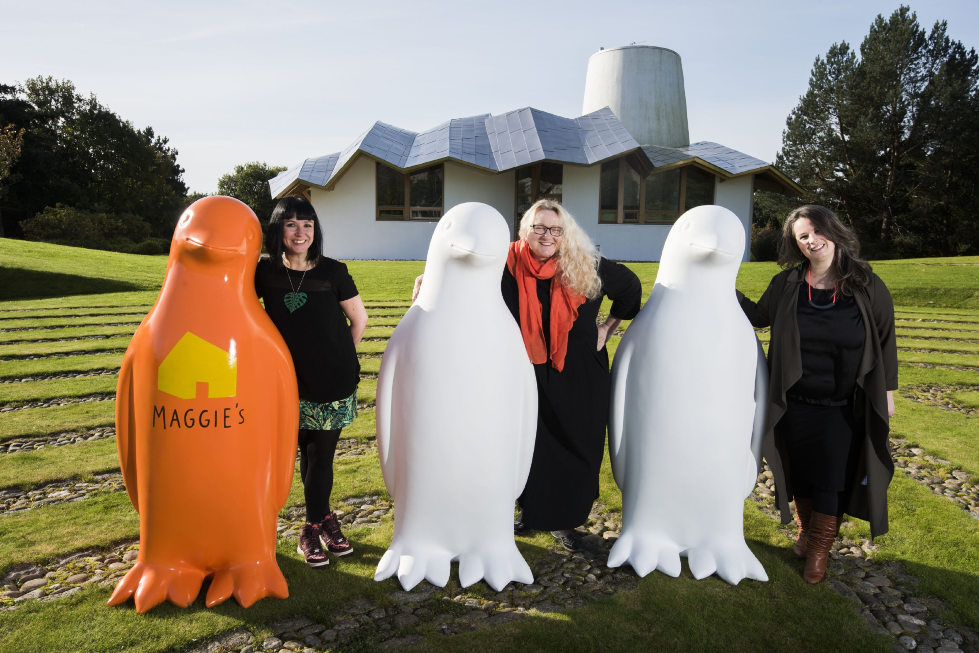 Artist coordinators Suzanne Scott and Joanne MacFadyen and penguin sculpture designer Janice Aitken.