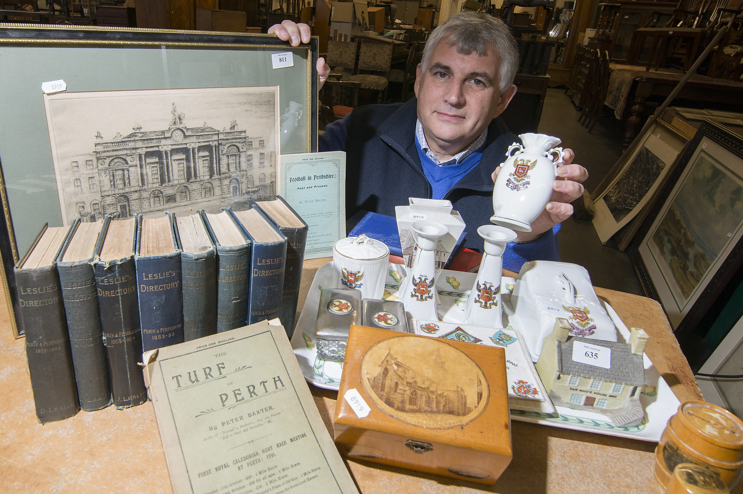 Iain Smithwith some of the items collected by  former councillor & Perth historian , Stan Keay