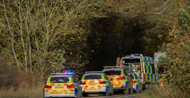 Police vehicles at the scene of the fatal accident.