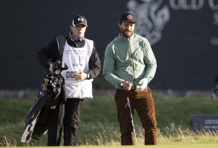 Actor Jamie Dornan watches on