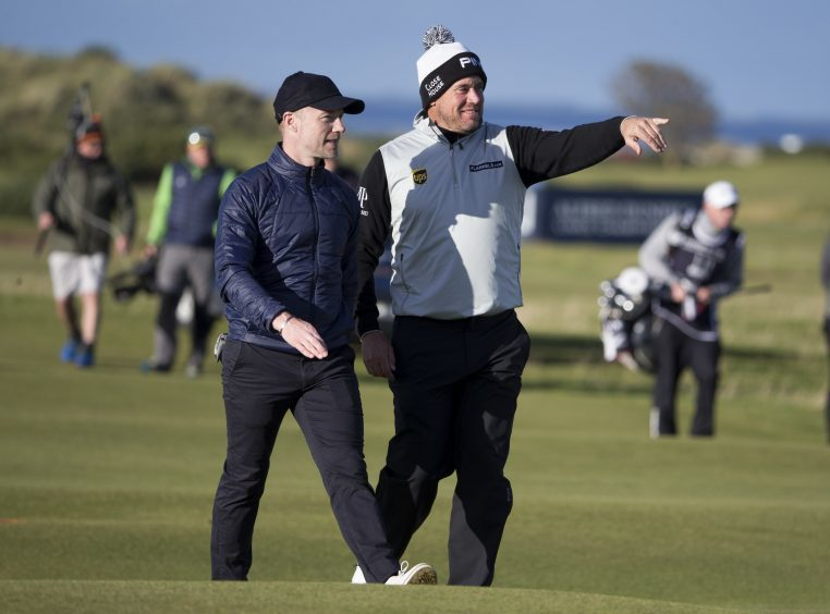 Lee Westwood (right) is pictured with singer Ronan Keating