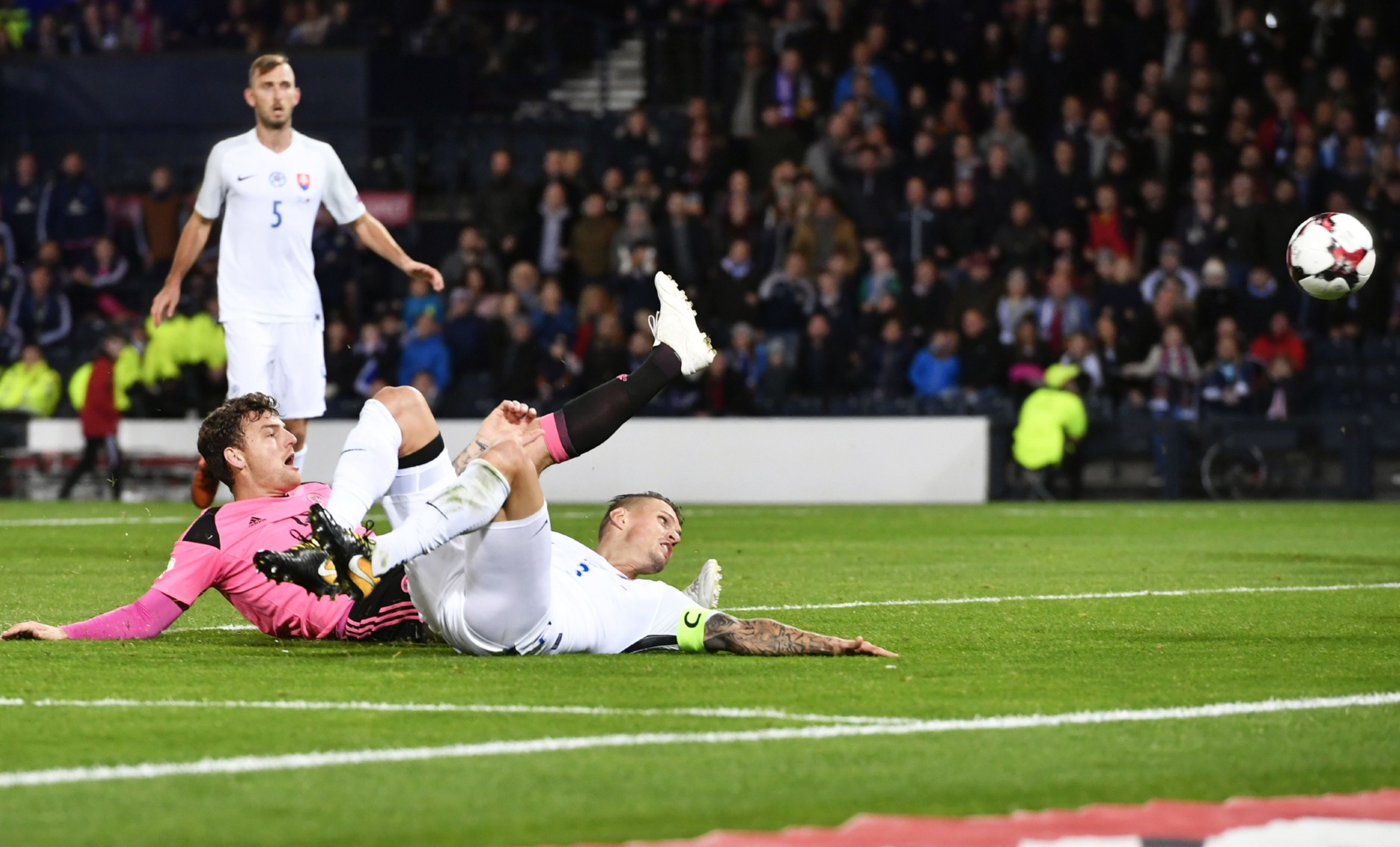 Chris Martin is beaten to the ball by Slovakian defender Martin Skrtel.