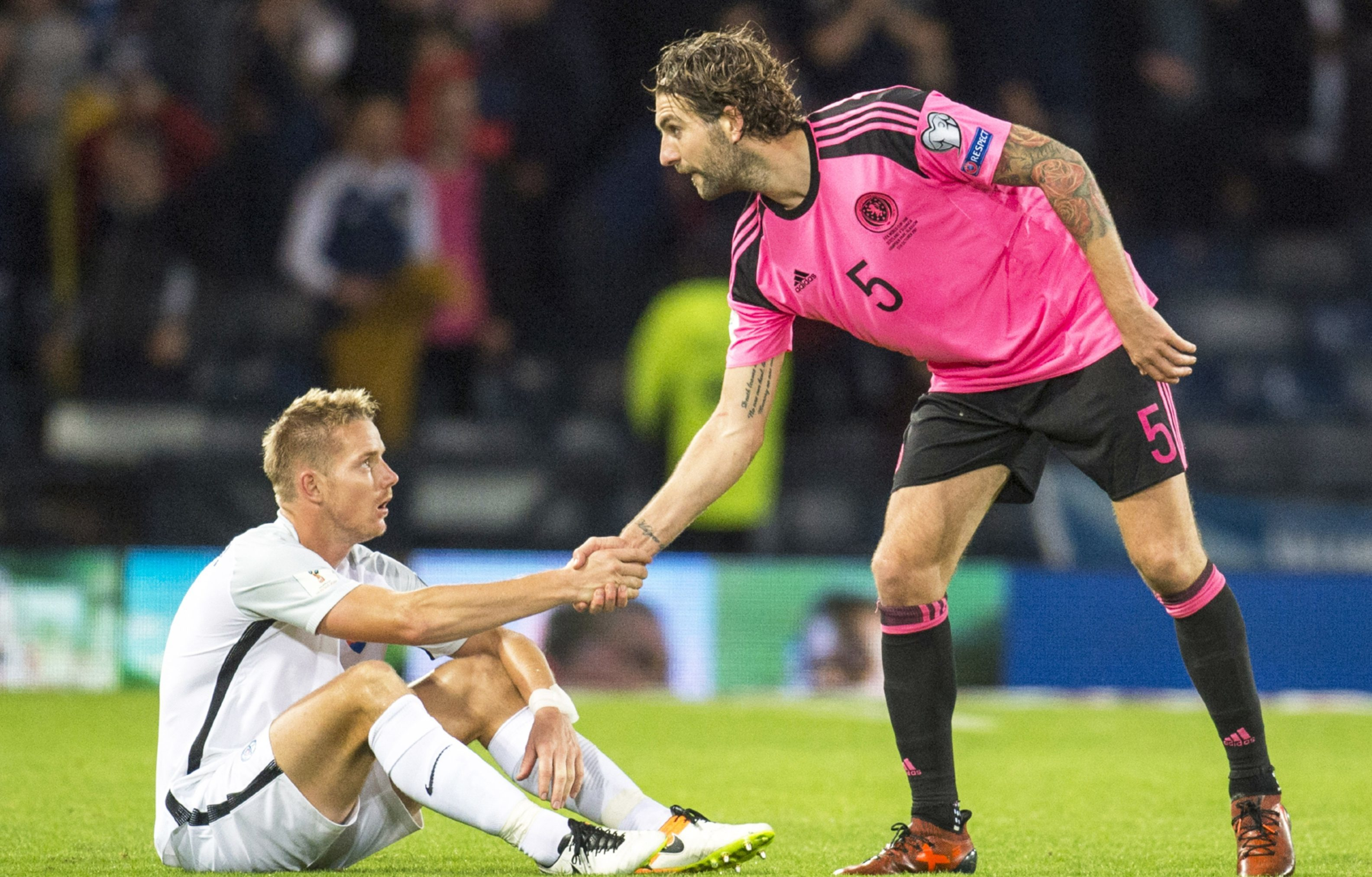 Hard luck pal! Charlie Mulgrew shakes hands with Slovakia's Tomas Hubocan at full-time.