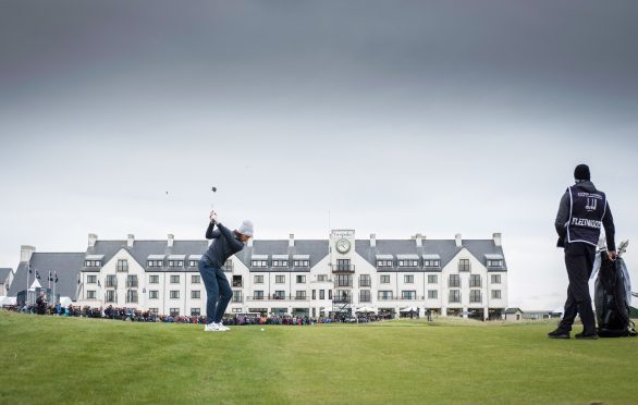 Tommy Fleetwood plays his approach into the 18th hole at Carnoustie during yesterday's record 63.