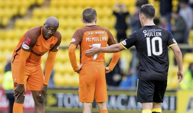 Dejection for United players William Edjenguele and Paul McMullan at full-time on Saturday.