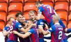 The Inverness players celebrate their opener
