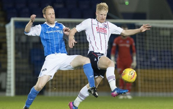 St Johnstone's Steven Anderson (left) competes for the ball with Ross County's Thomas Mikkelsen.