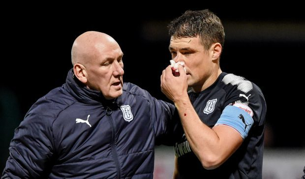 Darren O'Dea is helped off on Wednesday night.