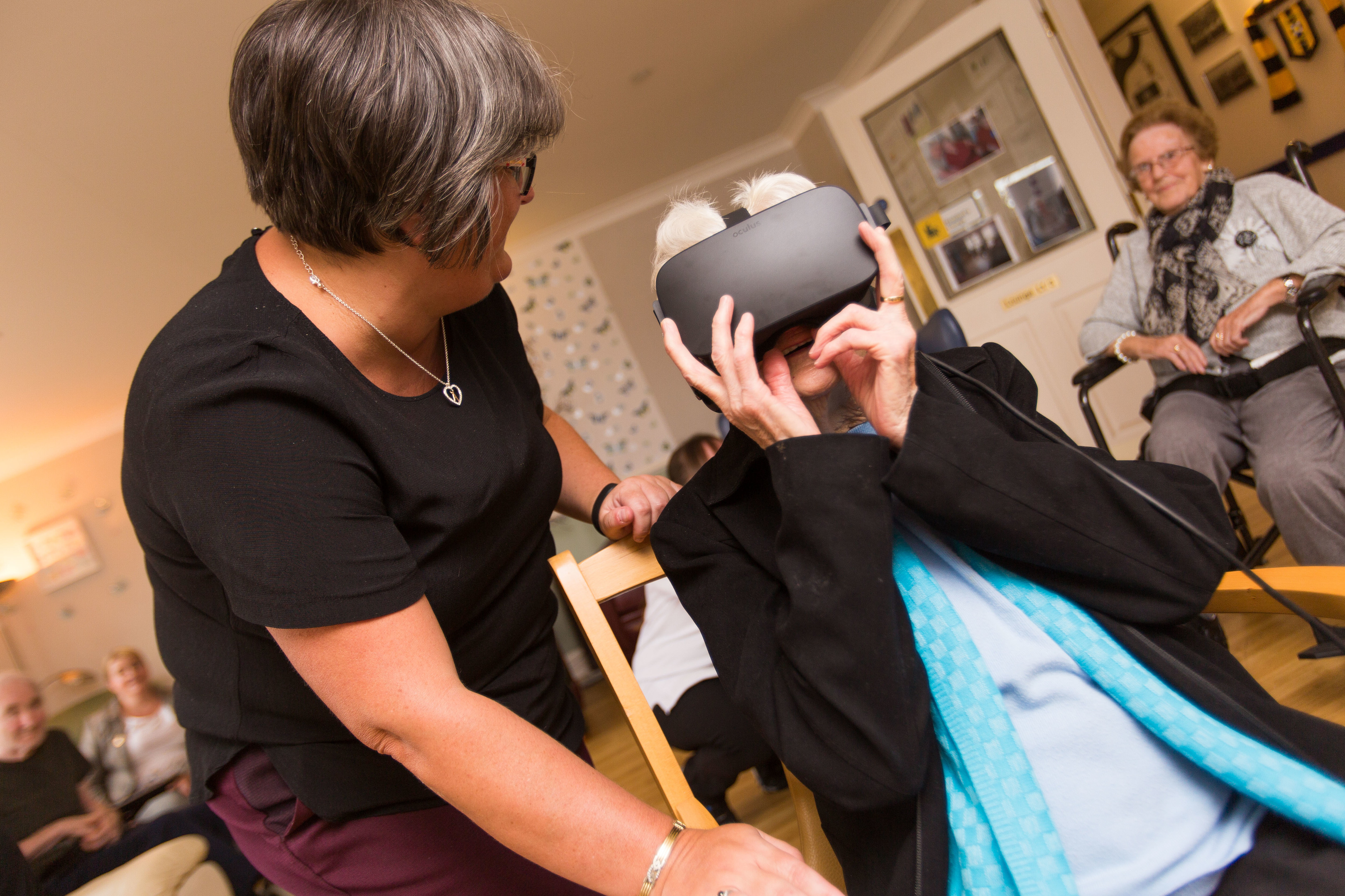 Courier News - Fife - Reporter Unknown - VR for Elderly Residents at Balhousie Care Home - Picture Shows: An emotional resident  Maureen Johnston is taken back to the street she grew up in Ireland as part of her VR Experience, guided by Staff member April Fleming - Wednesday 4 October 2017