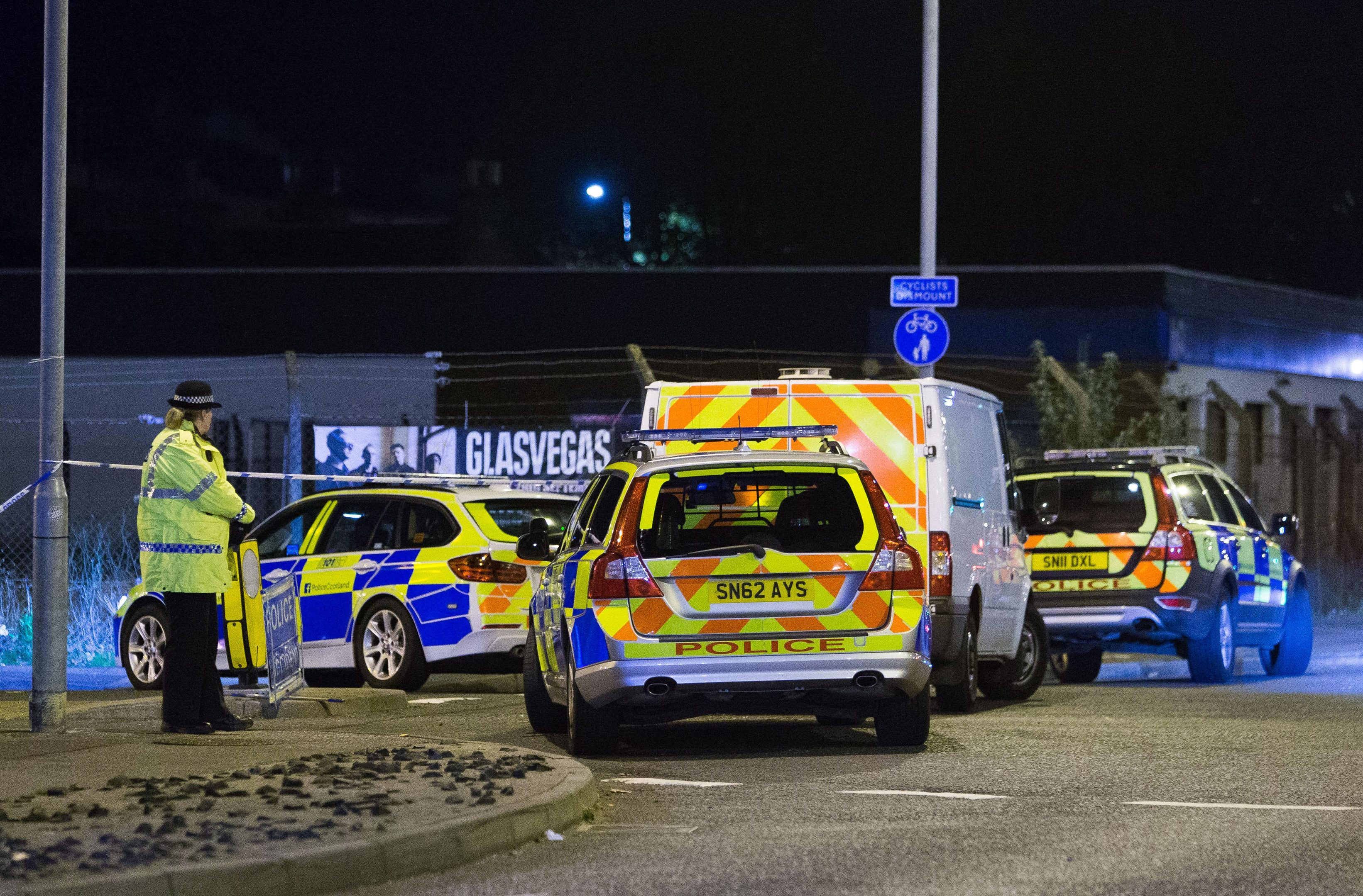 Police vehicles at the scene of the tragedy.