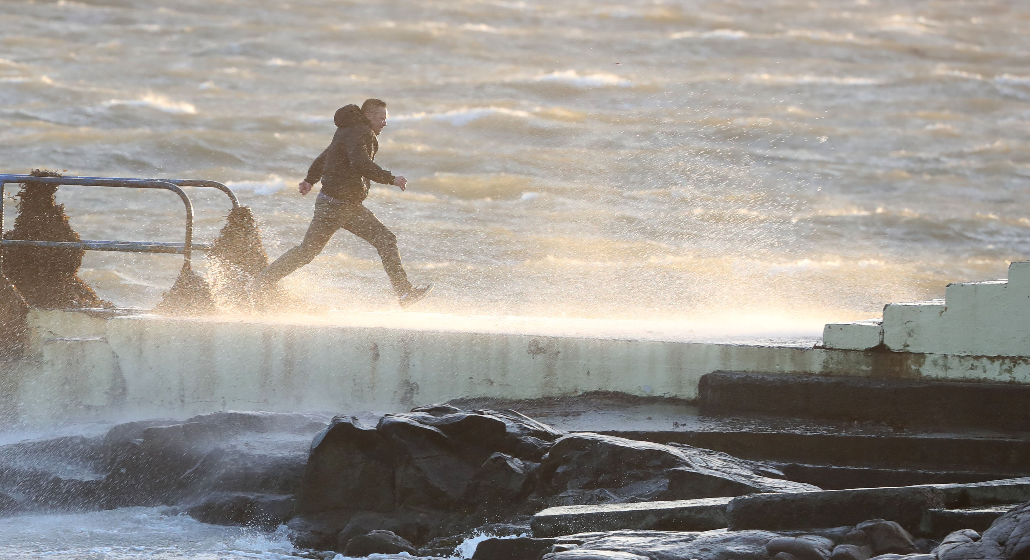Dare devils run out to a diving board Salthill, Galway, as Hurricane Ophelia batters the UK and Ireland earlier this week.