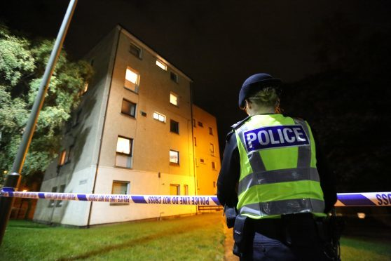 Police outside the flat in Nursery Road on the night of the incident.