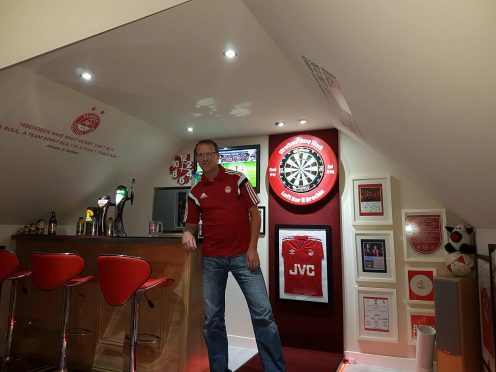 Graeme in his shrine to the Dons.