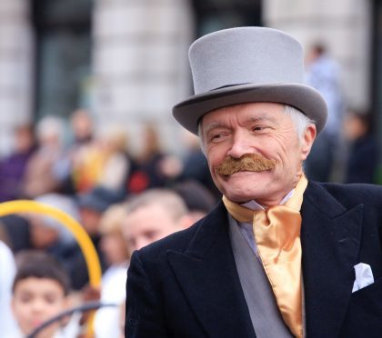 """""""London, United Kingdom - January 01, 2012: A man dressed up as a Victorian gentleman at the New Year's Day parade in London. On The Mall."""""""