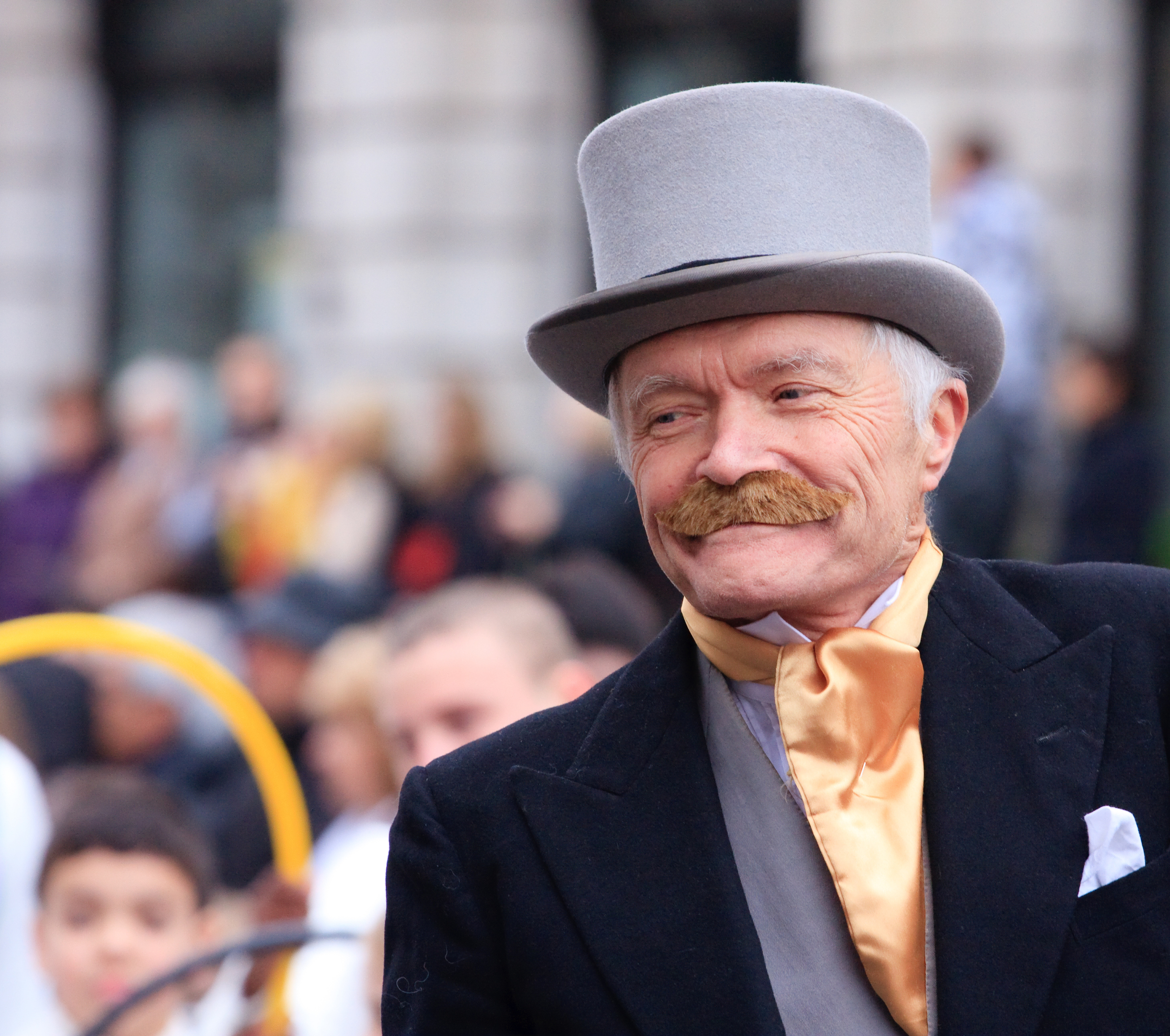 """London, United Kingdom - January 01, 2012: A man dressed up as a Victorian gentleman at the New Year's Day parade in London. On The Mall."""