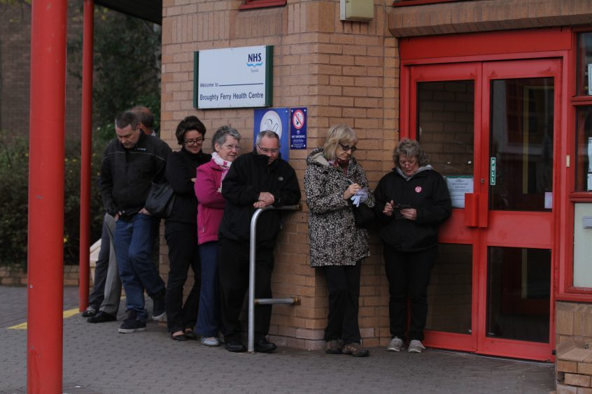 An early morning queue outside Broughty Ferry health centre.