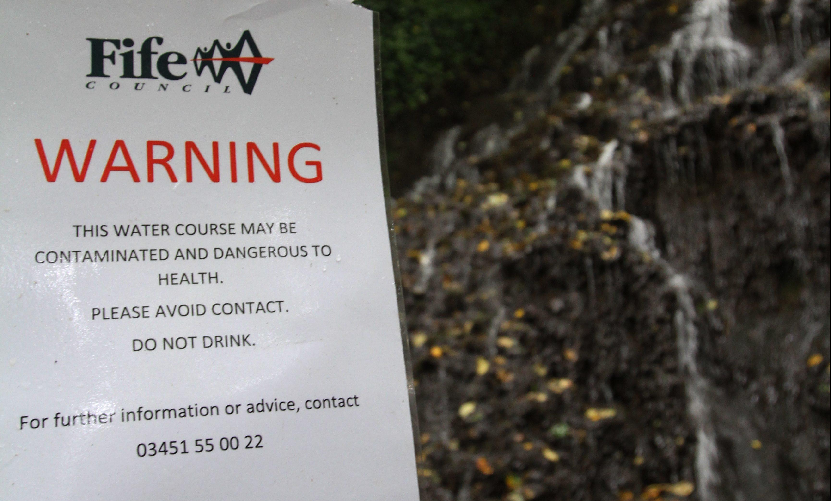 The waterfall at Starley Burn and the warning sign.