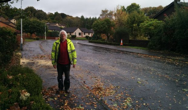 Tom Rush next to the road in Dunvegan Avenue.