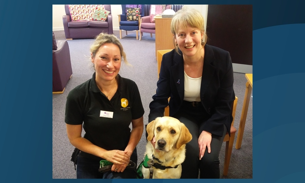 Shona Robison, right, meeting Fiona Corner and Uno from the Dementia Dogs Project.