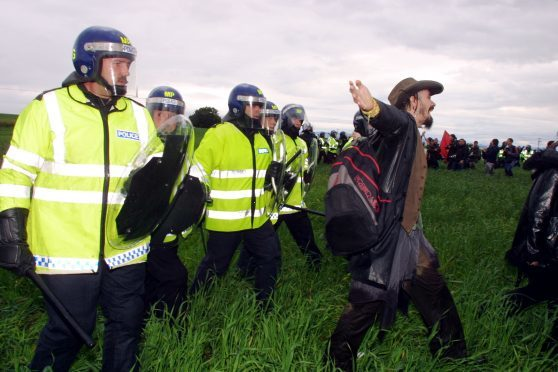 Police force protestors from the perimeter fence at Gleneagles Hotel during the G8 summit..