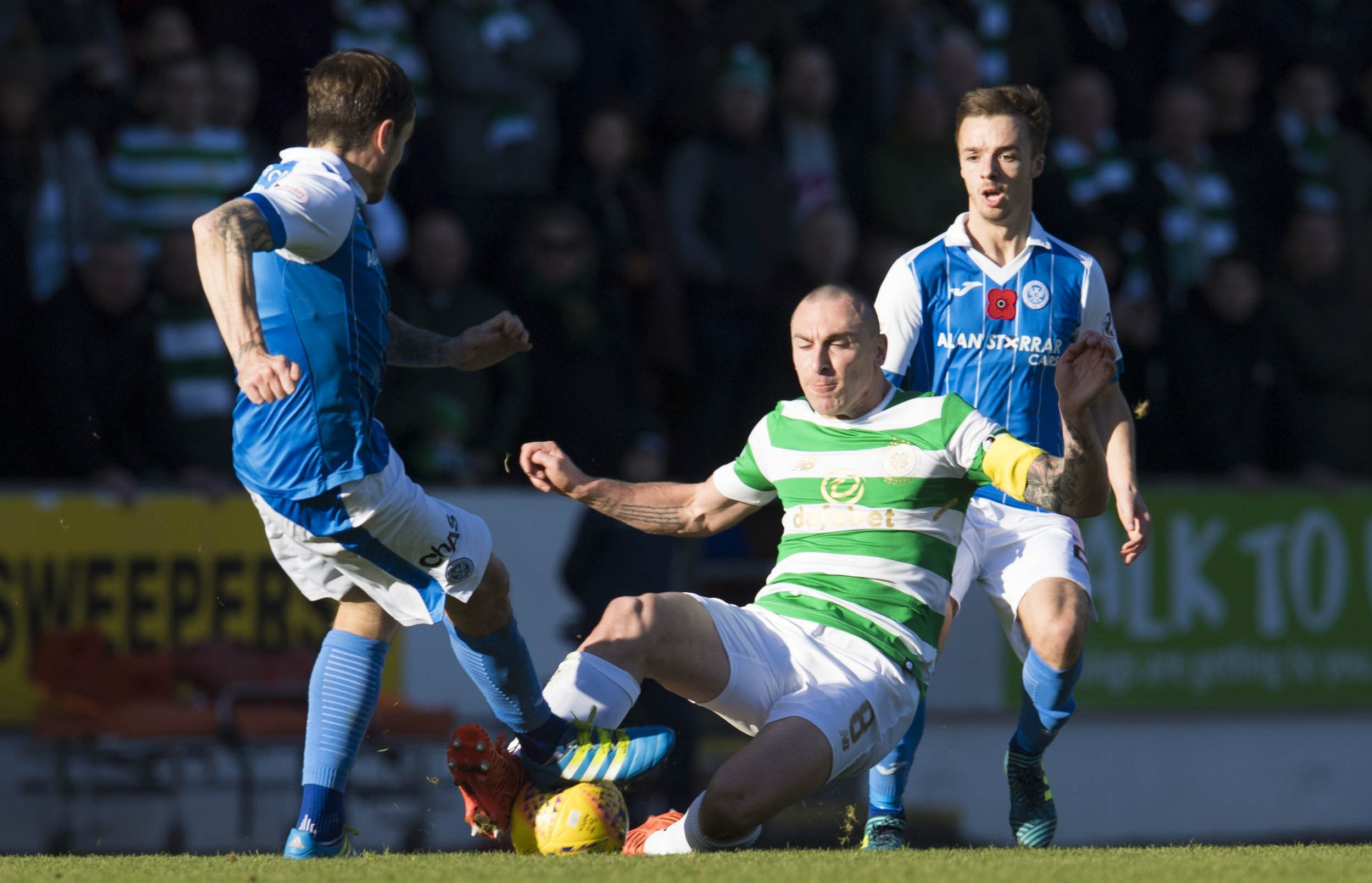 Celtic's Scott Brown challenges St Johnstone's Paul Paton.
